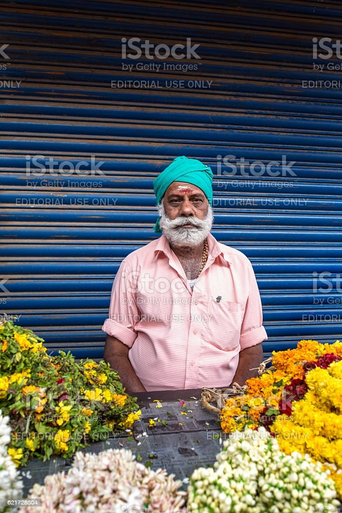 Unidentified sikh man sell flowers on streets of Cochin, India stock photo