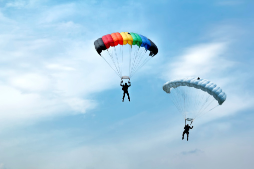 Unidentified Skydivers On Blue Sky Stock Photo - Download Image Now