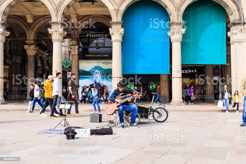 Unidentified street performer at Duomo di Milano royalty-free stock photo