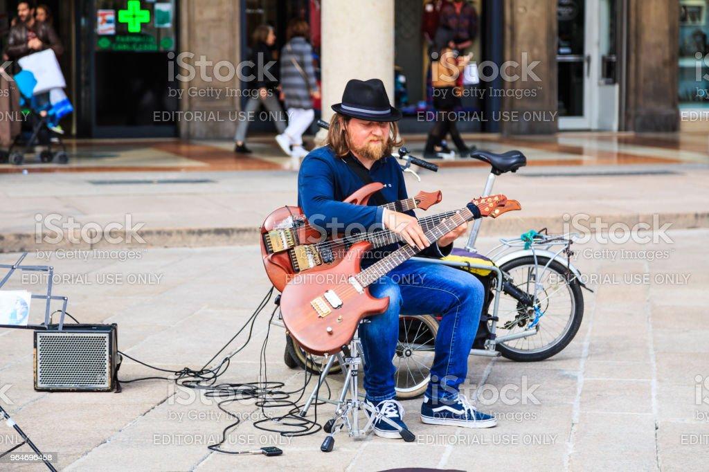 Unidentified street performer at Duomo di Milano royalty-free stock photo