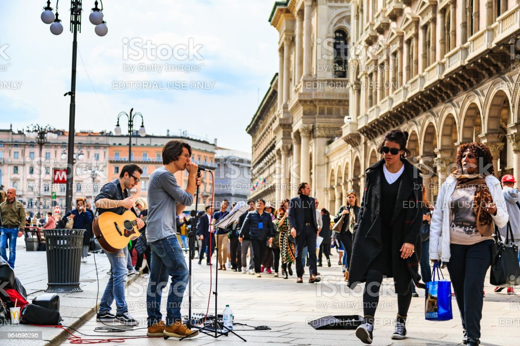 Unidentified street performers at Duomo di Milano royalty-free stock photo