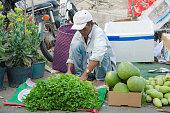 Phan Thiet, Vietnam - February 6, 2016: Unidentified street vendor at Phan Thiet market. Vietnam