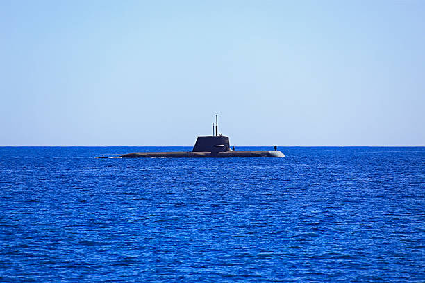 Unidentified submarine on ocean surface for maintenance stock photo