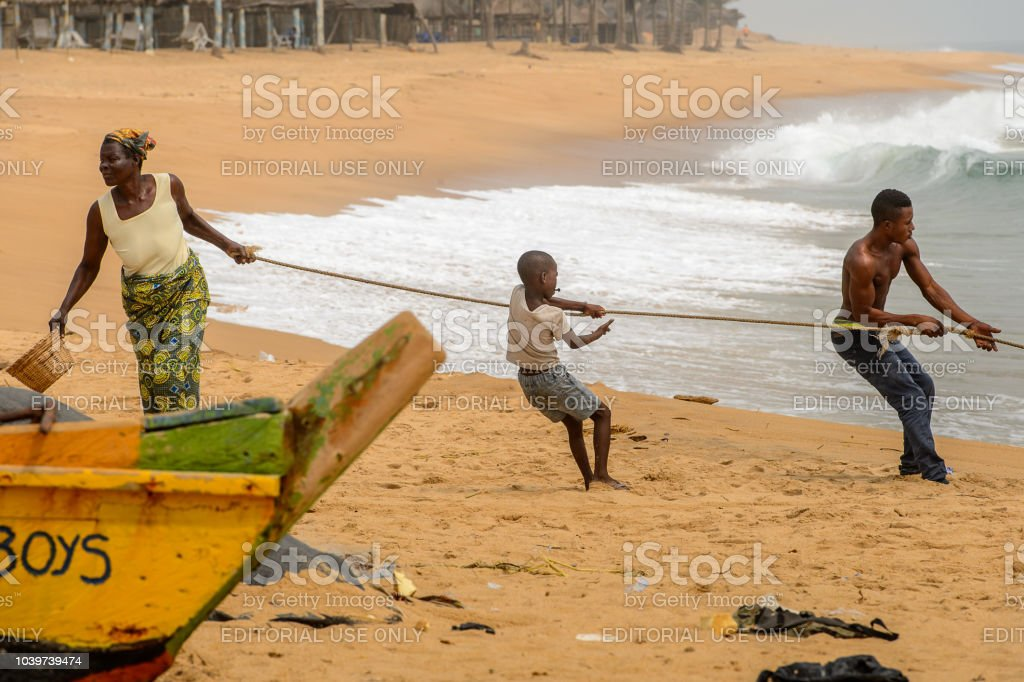 Unidentified Togolese People Hold The Rope On The Coast Of