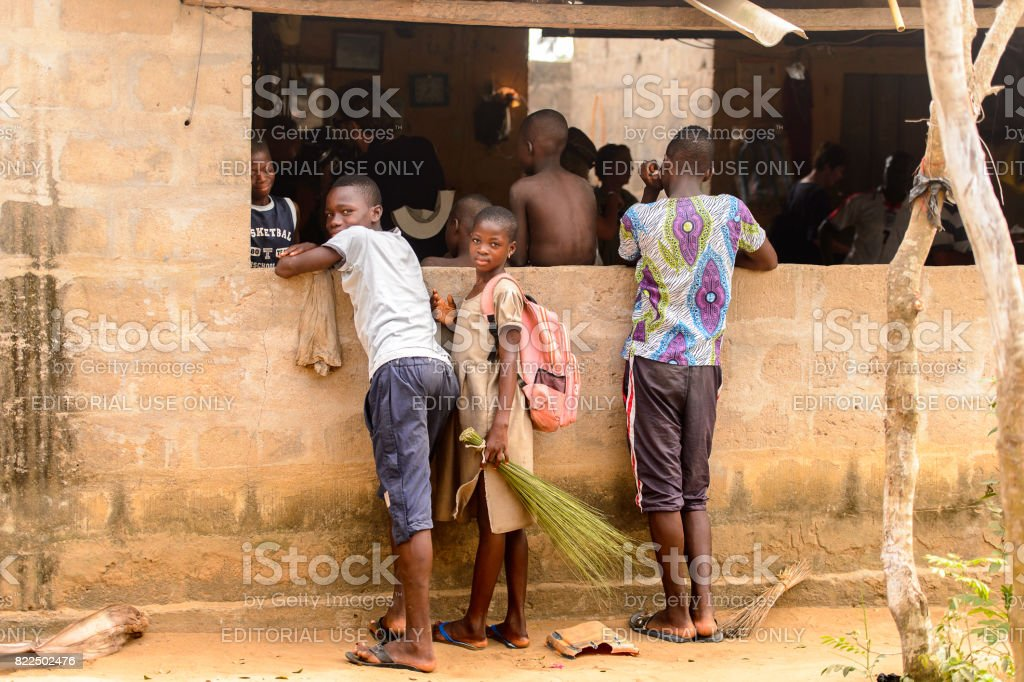 LOME, TOGO - Jan 9, 2017: Unidentified Togolese people stand near the local shaman's house. Togo people suffer of poverty due to the bad economy stock photo