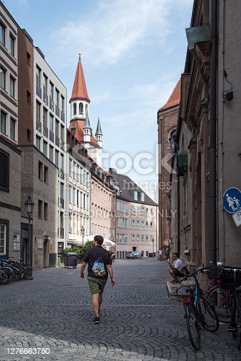 istock Unidentified tourist walking on street in Munich 1276663750