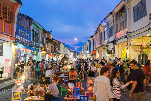 unidentified tourists are shopping at old town night market - phuket stock photos and pictures