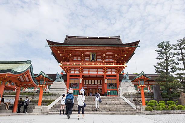 Unidentified tourists visit Fushimi Inari Shrine in Kyoto, Japan Kyoto, Japan - April 23, 2016: Unidentified tourists visit Fushimi Inari Shrine in Kyoto, Japan. shinto shrine stock pictures, royalty-free photos & images