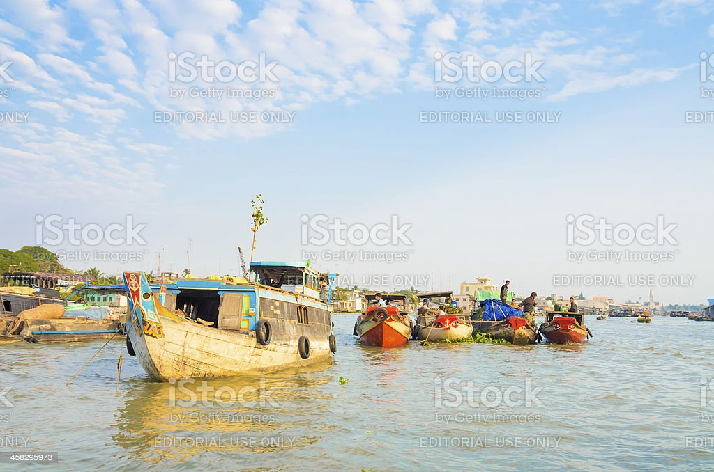 Unidentified traders on their boats at Cai Be Floating Market royalty-free stock photo