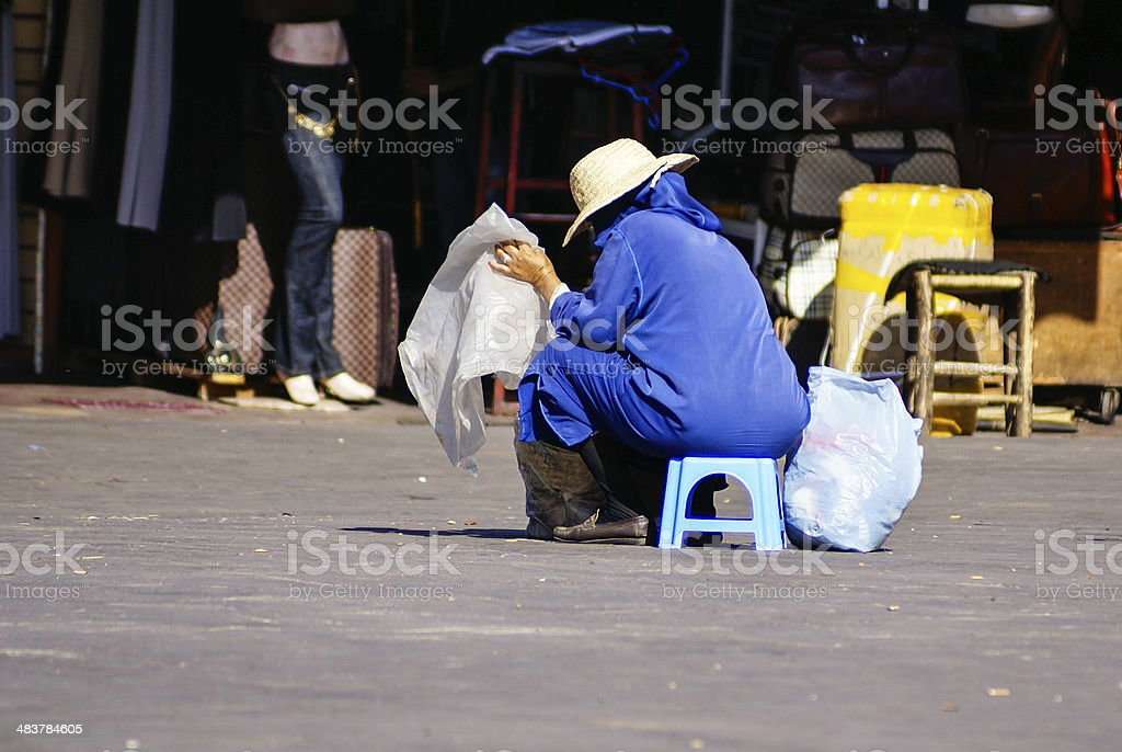 Unidentified woman at a street in Marrakesh stock photo