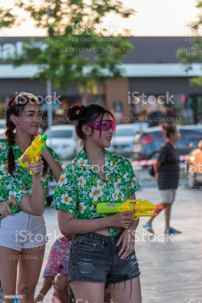 Bangkok, Thailand - April 15, 2017 : Unidentified women play and enjoying splashing with waters gun in Songkran Festival. stock photo