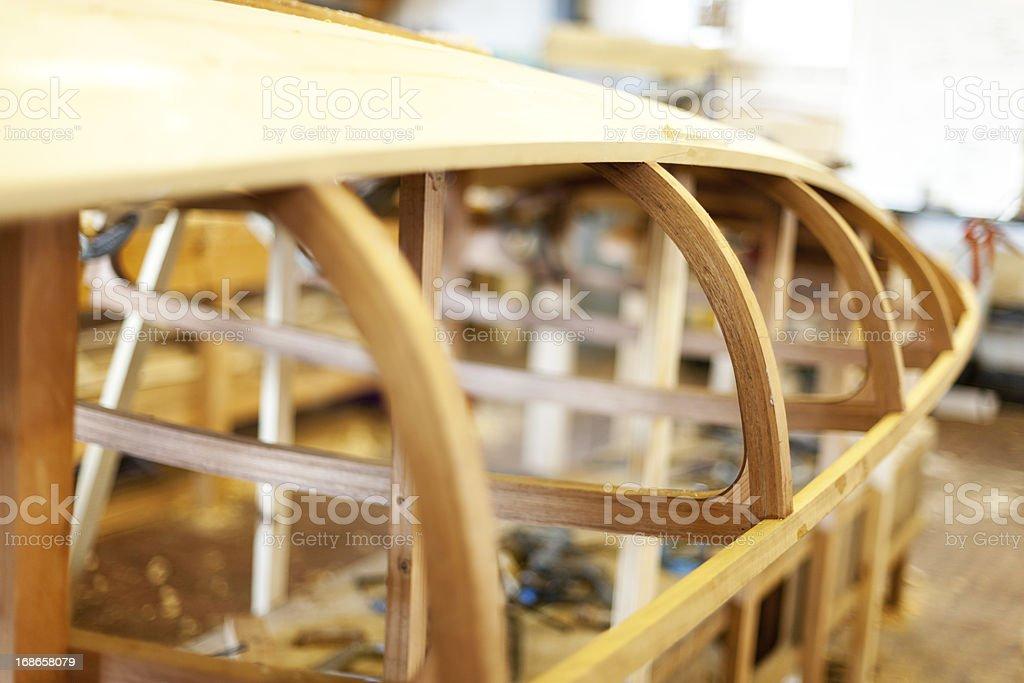 Unifinished wooden boat frame stock photo