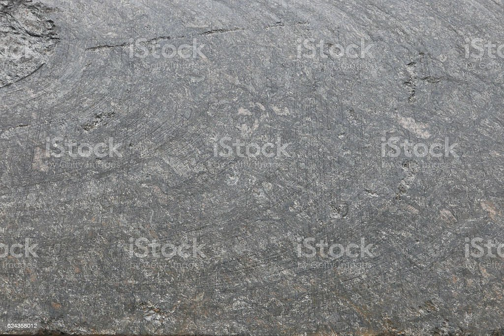 Uniform stone texture with cracks and natural rows stock photo