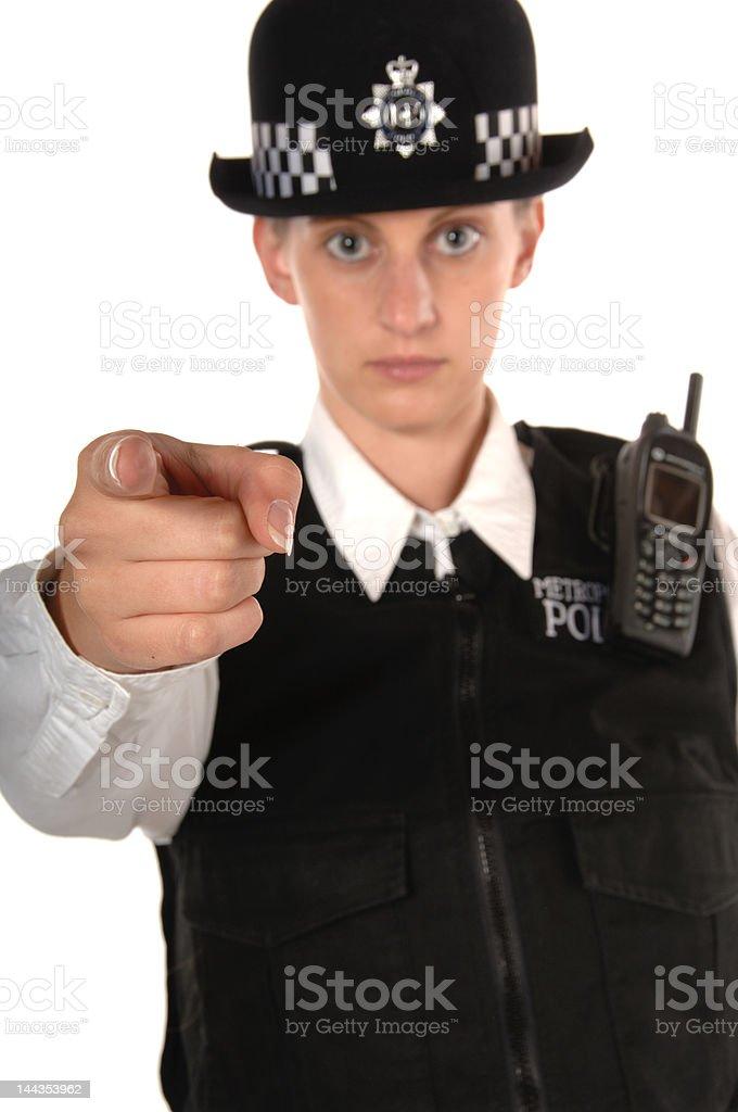 Uniformed Female UK Police Officer pointing finger royalty-free stock photo