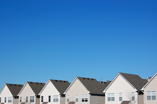 A row of houses (townhouses or condominiums) all looking the same.Also please feel free to review my other multiple housing photos: