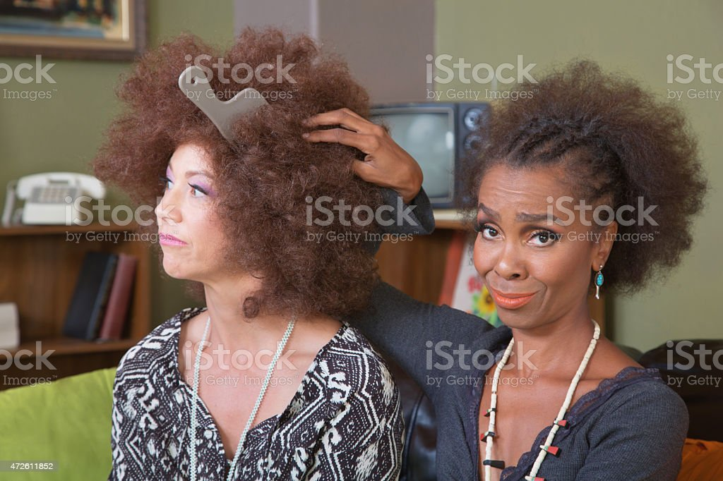 Unimpressed Lady with Friend stock photo