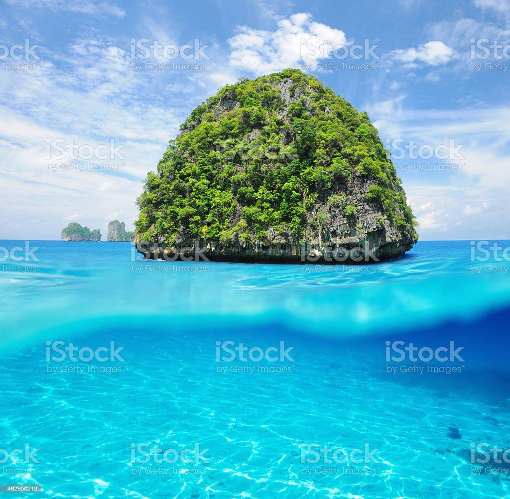 Uninhabited island with white sand bottom underwater view stock photo