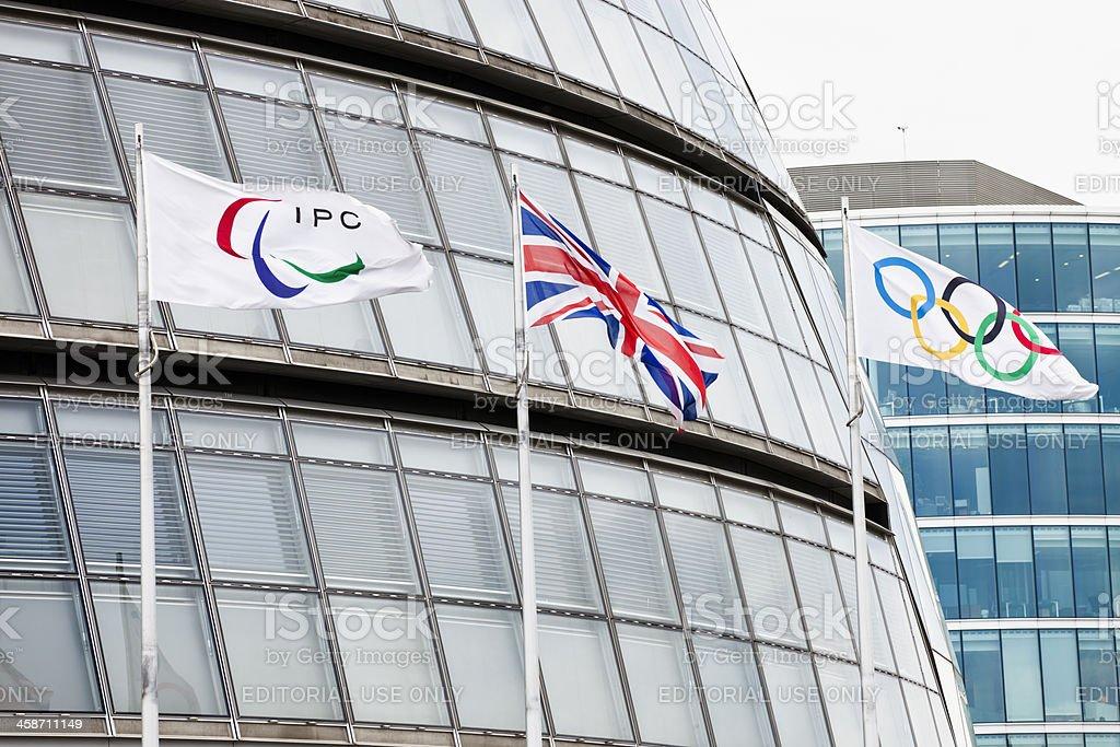 IPC, Union and Olympic flag near City hall in London stock photo