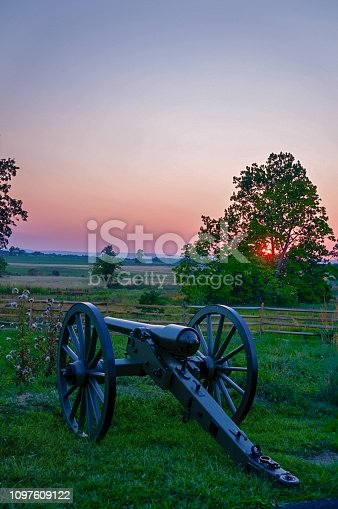 A Union cannon on Cemetery Ridge face the setting sun and the fields of Pickett's Charge in Gettysburg National Military Park.