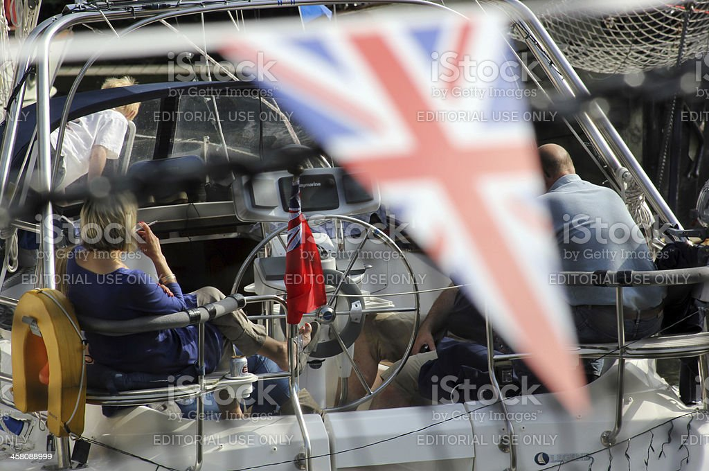 Union Flag and boat moored at St Katharine Docks, London stock photo