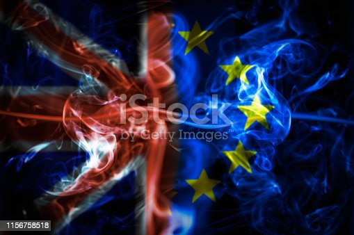 Union Jack And Flag Of The Europe Over A Smoky Background