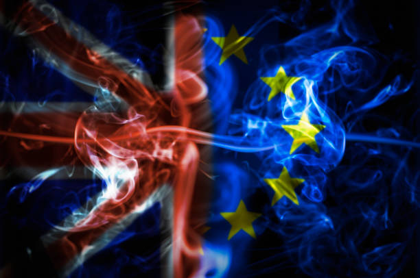 Union Jack And Flag Of The European Union Over A Smoky Background stock photo