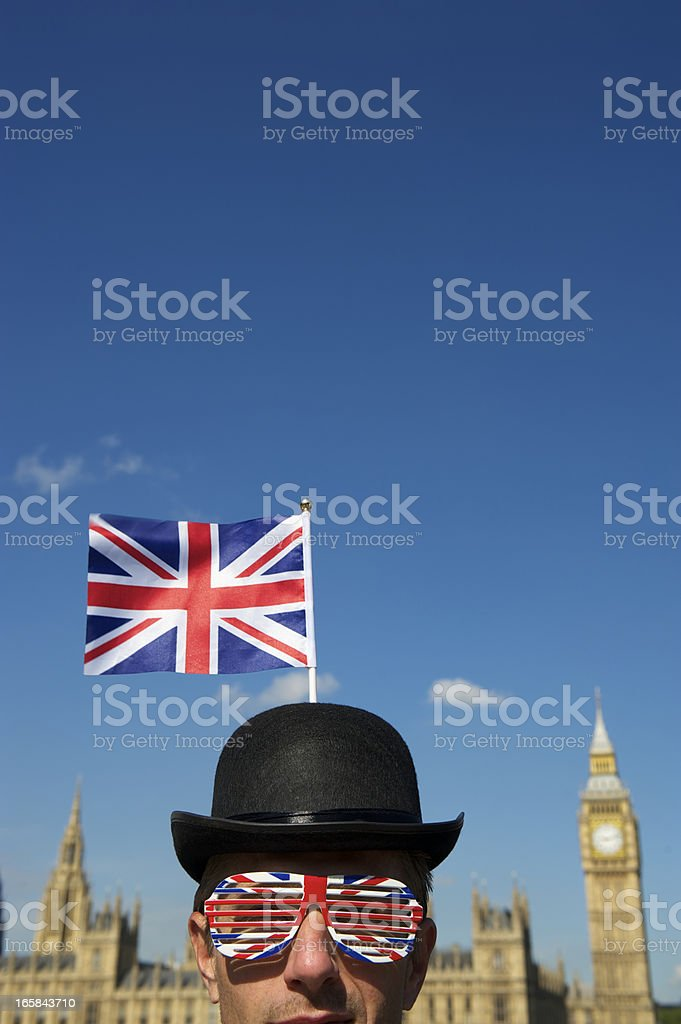 Union Jack Bowler Hat Man Stands at Westminster London stock photo