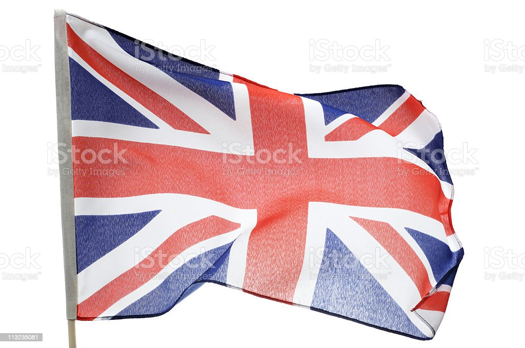 union jack British flag blowing in wind against white royalty-free stock photo