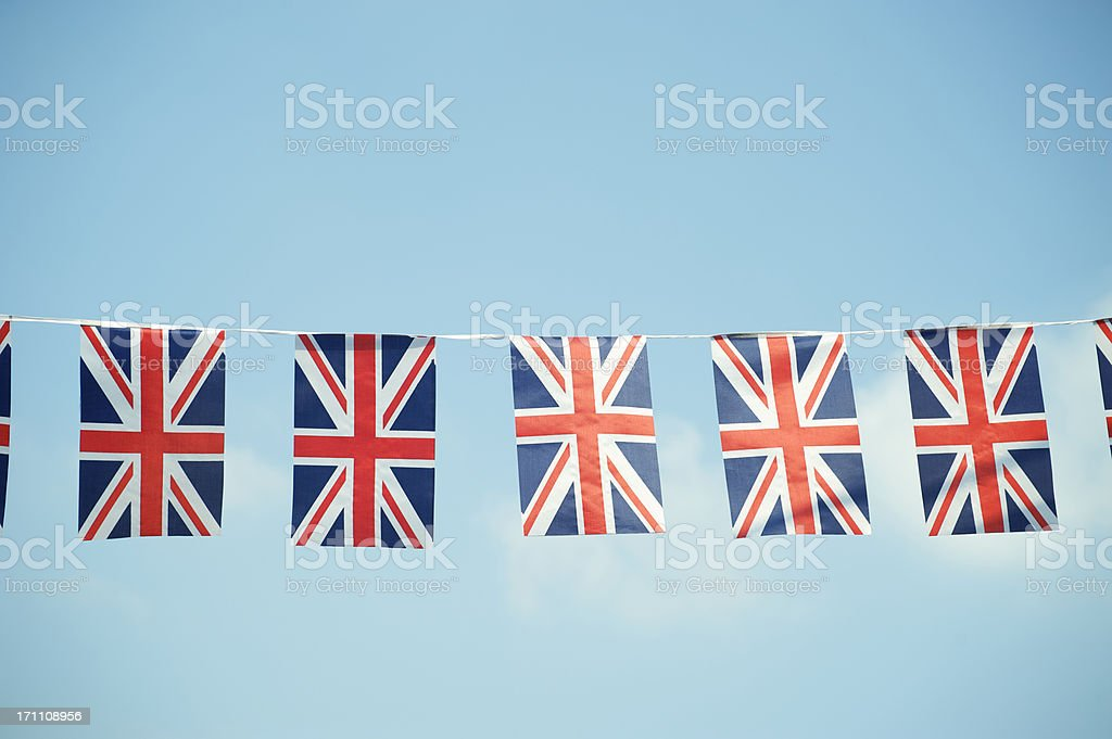 Union Jack British Flags Blue Sky Horizontal stock photo
