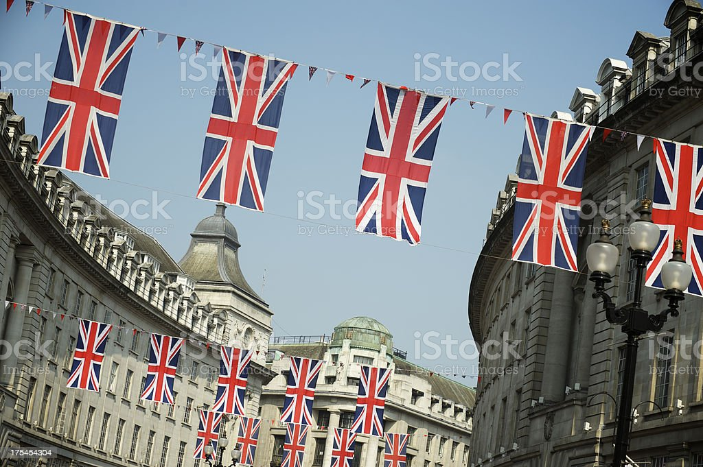 Union Jack British Flags Hang Across London Street stock photo