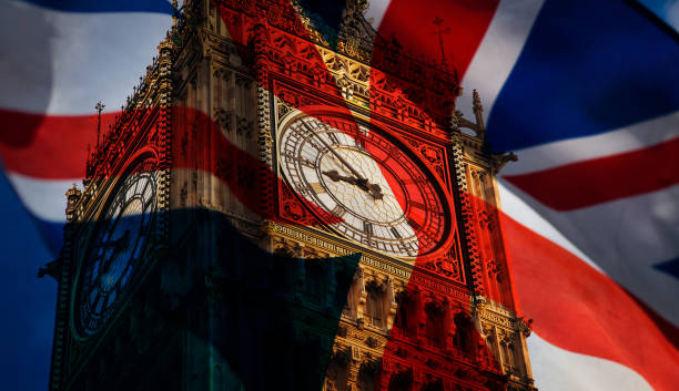 union jack flag and iconic Big Ben at the palace of Westminster, London - the UK prepares for new elections stock photo