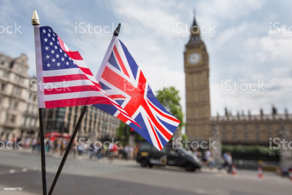 Union Jack flag and the Stars and Stripes flag of the USA, fluttering together in front of Big Ben in Westminster, London stock photo