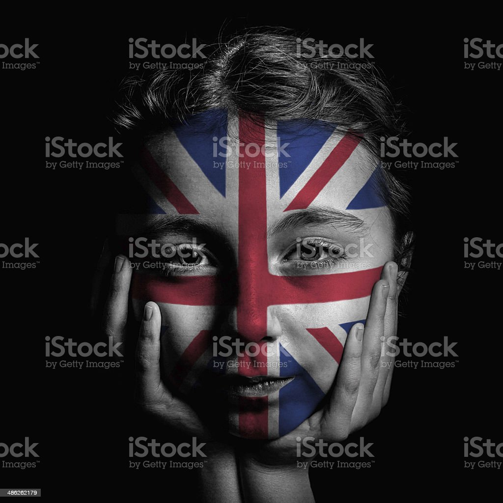 union jack flag, face paint on girl, with black background stock photo