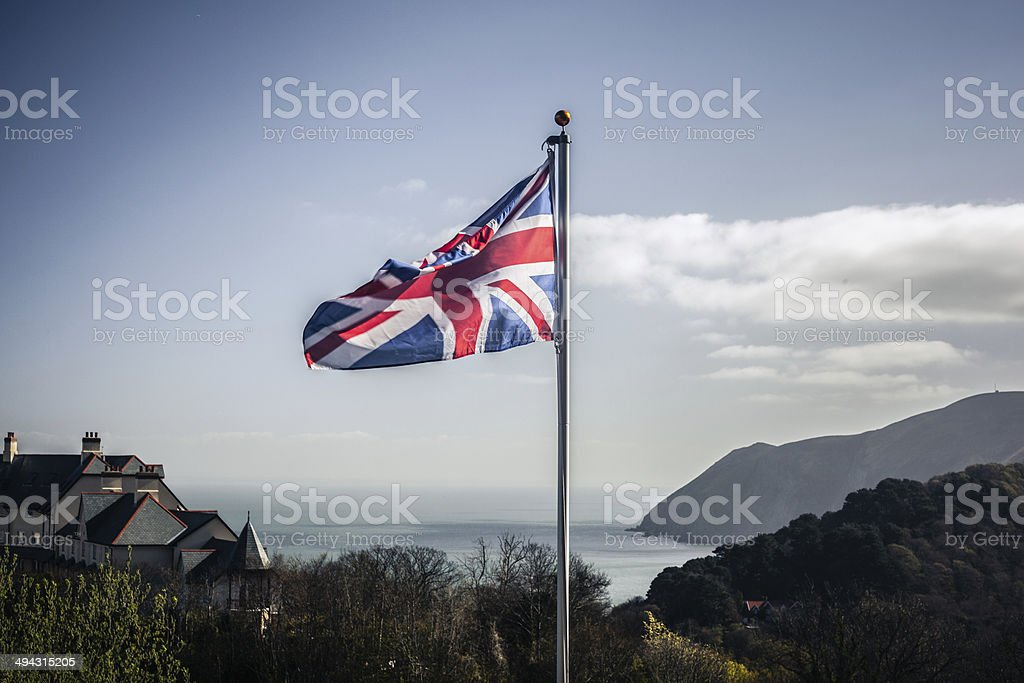 Union jack flag in the wind stock photo