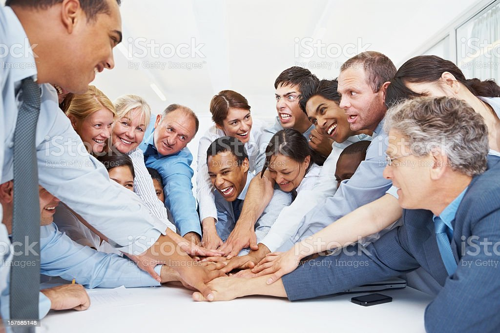 Union of business people with their hands together royalty-free stock photo