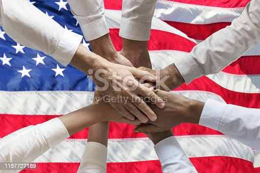 istock Union or Team Hands multcultural people team over usa or us or Americanflag topview 1157727189