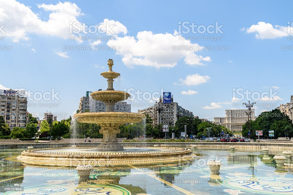 Union Square Fountain And Parliament Palace In Bucharest royalty-free stock photo
