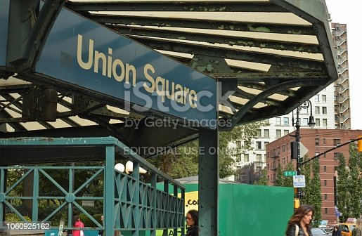 1202686823istockphoto Union Square NYC Sign New York City People Street Trendy Busy Manhattan 1060925162