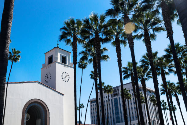Union Station surrounded by palm trees, Los Angeles, California Union Station surrounded by palm trees and blue sky, Los Angeles, California alameda california stock pictures, royalty-free photos & images