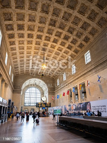 Toronto, Ontario, Canada - July 30, 2019:  Union Station is the central public transportation hub in Downtown Toronto.  It serves as at the main hub for Via Rail, the Canadian cross country rail system.  It also serves as a daily commuter hub for Toronto workers, hosting light rail systems from suburbs and neighbouring municipalities.  The structure itself has an impressive architectural arch and, despite its age, retains an aura of elegance.  Union Station is located on Front Street in Downtown Toronto.