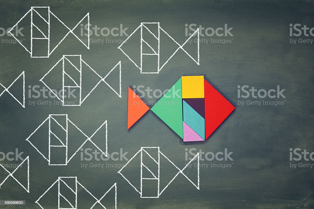 unique different fish made from tangram puzzle shape stock photo
