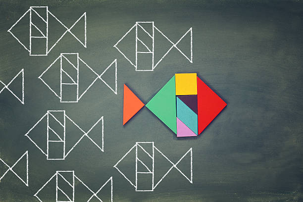 unique different fish made from tangram puzzle shape - gegensatz stock-fotos und bilder