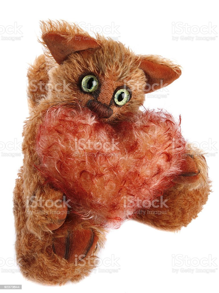 unique ginger Cat holding fluffy heart over white royalty-free stock photo