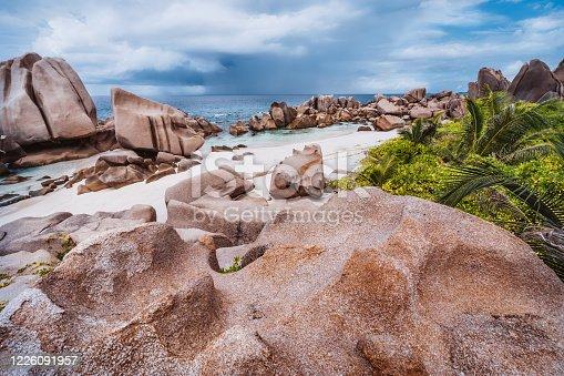 Unique granite rocks and cute remote and hidden Anse Marron beach in La Digue island, Seycheles islands.