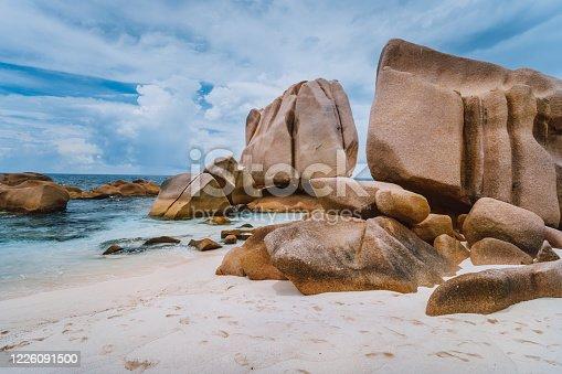 Unique granite rocks at remote Anse Marron beach in La Digue island, Seycheles islands.