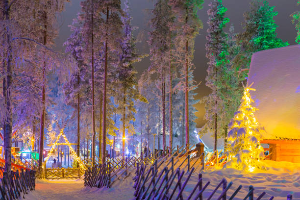 Unique Lapland Suomi Houses Over the Polar Circle in Finland at Christmas Time. Located in Front of Amazing Winter Forest Scenery in Finland