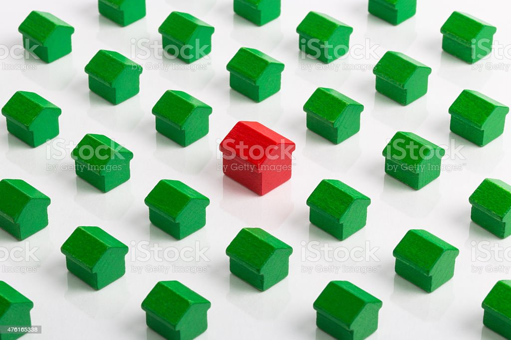 Unique large red house in group stock photo
