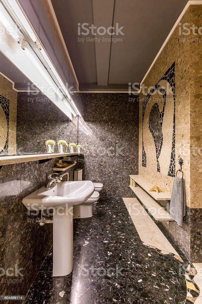 Unique luxury of dark stylish bathroom stock photo