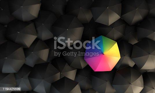 Rainbow colored umbrella between the black umbrellas. ( 3d render )