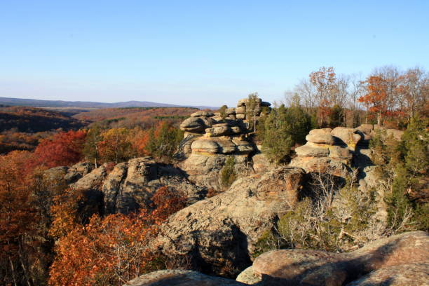 Unique Rock Formation with Fall Colors A unique rock formation at Garden of the Gods is surrounded by bright fall colors in Shawnee National Forest. national forest stock pictures, royalty-free photos & images
